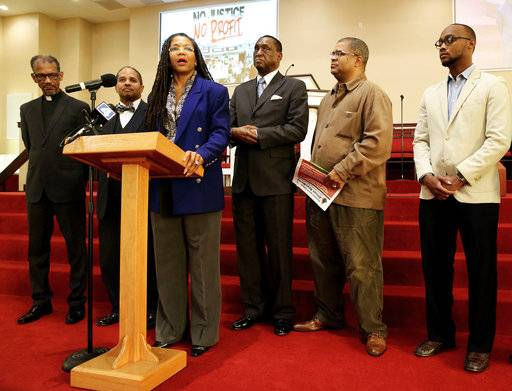 The Rev. Dinah Tatman, center, with Greater New Vision Ministries, Inc., announces details of a new economic boycott flanked other clergy members looking on Thursday, Nov. 2, 2017 in St. Louis, Mo. Tatman said African-Americans are subjected to excessive force by police, criminalized for minor infractions and saddled with long sentences. She also cited economic disparities, efforts to diminish voting rights and political redistricting that has made it harder for black people to have their voices heard. (Christian Gooden/St. Louis Post-Dispatch via AP)
