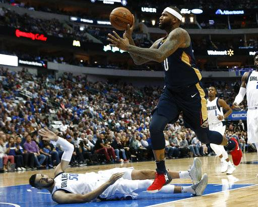 Dallas Mavericks center Salah Mejri (50), of Tunisia, goes to the floor after colliding with New Orleans Pelicans center DeMarcus Cousins (0) during the first period of an NBA basketball game, Friday, Nov. 3, 2017, in Dallas. (AP Photo/Mike Stone)