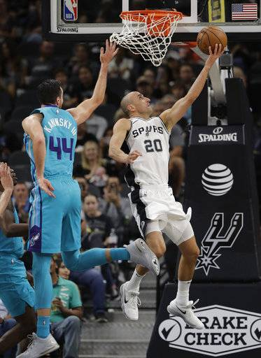 San Antonio Spurs guard Manu Ginobili (20) scores past Charlotte Hornets forward Frank Kaminsky (44) during the first half of an NBA basketball game, Friday, Nov. 3, 2017, in San Antonio. (AP Photo/Eric Gay)