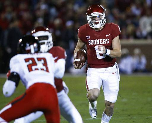 Oklahoma quarterback Baker Mayfield (6) carries in the first quarter of an NCAA college football game against Texas Tech in Norman, Okla., Saturday, Oct. 28, 2017. (AP Photo/Sue Ogrocki)