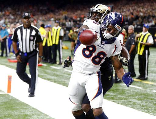 FILE - In this Nov. 13, 2016, file photo, Denver Broncos wide receiver Demaryius Thomas (88) pulls the ball away from New Orleans Saints cornerback Delvin Breaux (40) after a touchdown reception in the second half of an NFL football game in New Orleans. Thomas is closing in on a full year since scoring his last touchdown. Though he is on pace for a sixth consecutive 1,000-yard season, what he really wants is to end his streak without a touchdown and his next chance comes Sunday in Philadelphia. (AP Photo/John McCusker, File)