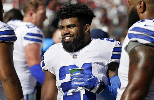 FILE - In this Sunday, Oct. 22, 2017, file photo, Dallas Cowboys running back Ezekiel Elliott smiles on the sideline after scoring a touchdown during the second half of an NFL football game against the San Francisco 49ers in Santa Clara, Calif. A federal appeals court says Elliott can play in Sunday's home game against Kansas City. The 2nd U.S. Circuit Court of Appeals in New York on Friday, Nov. 3, 2017, temporarily blocked a lower-court ruling that required Elliott to begin serving a six-game suspension. (AP Photo/Eric Risberg, File)