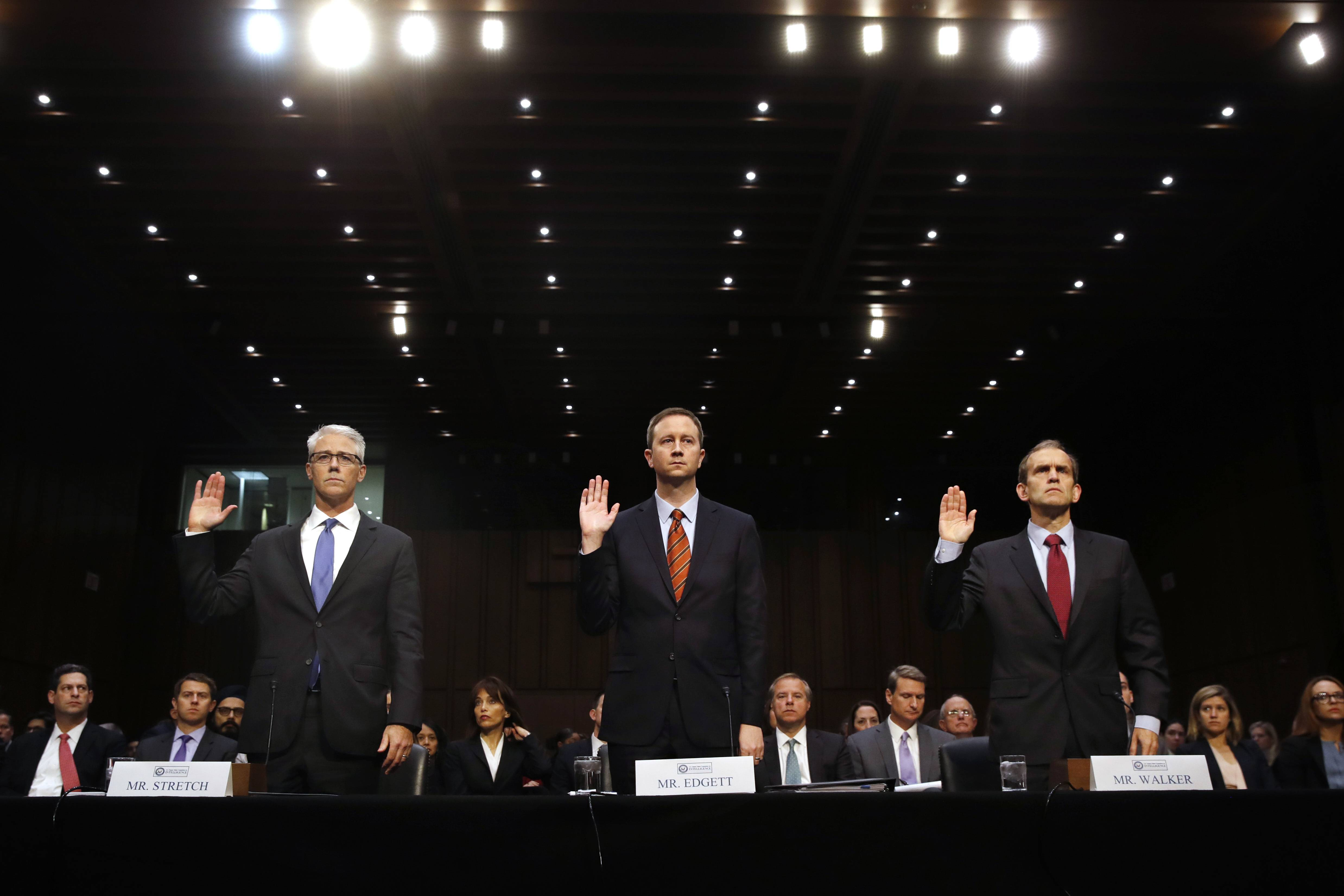 From left, Facebook's General Counsel Colin Stretch, Twitter's Acting General Counsel Sean Edgett, and Google's Senior Vice President and General Counsel Kent Walker, are sworn in for a Senate Intelligence Committee hearing on Russian election activity and technology, Wednesday, Nov. 1, 2017, on Capitol Hill in Washington.