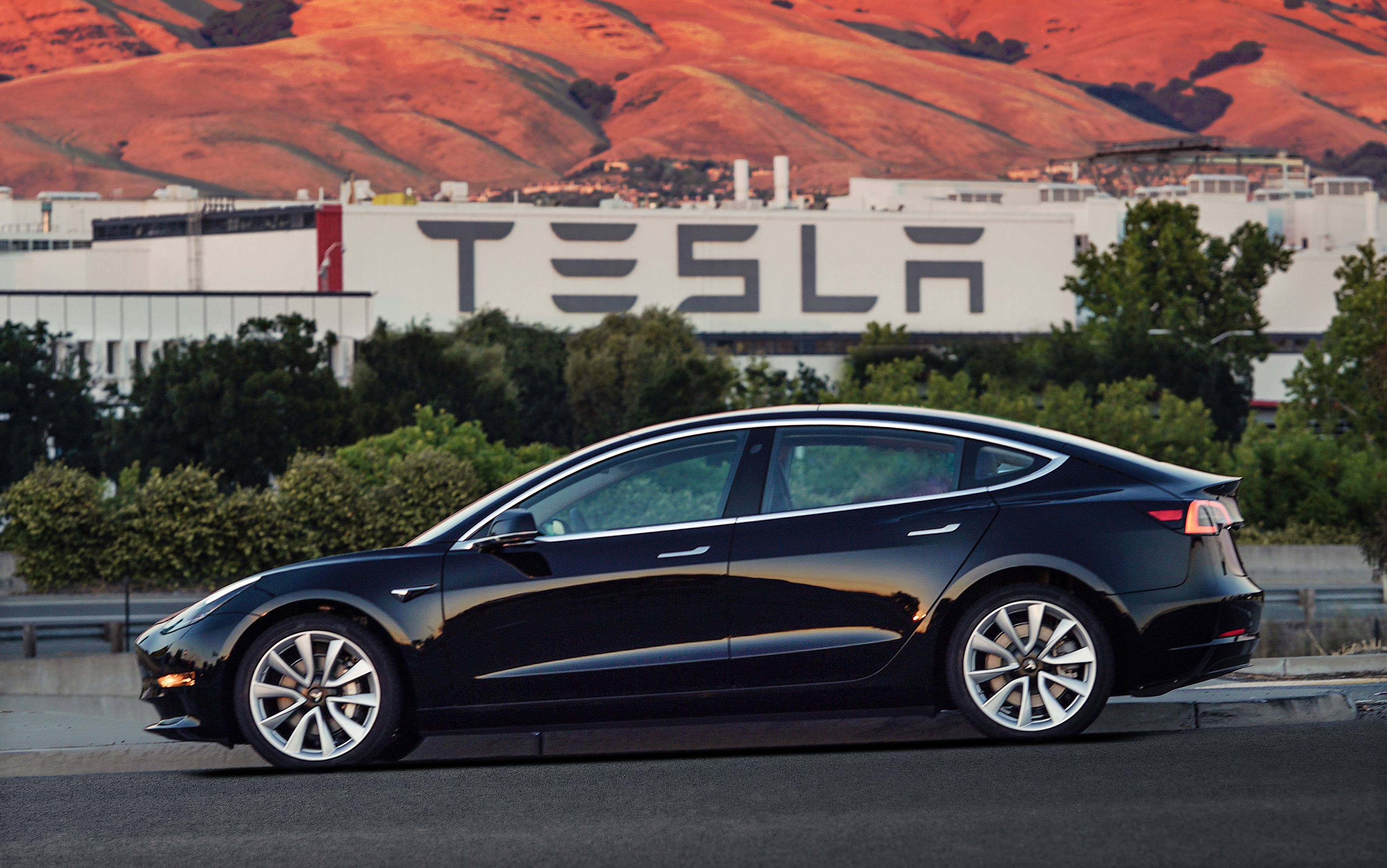 Tesla updated its website for customer reservations on Wednesday, including a table that shows the base Model 3 won't be available until some time next year.(Courtesy of Tesla Motors via AP)