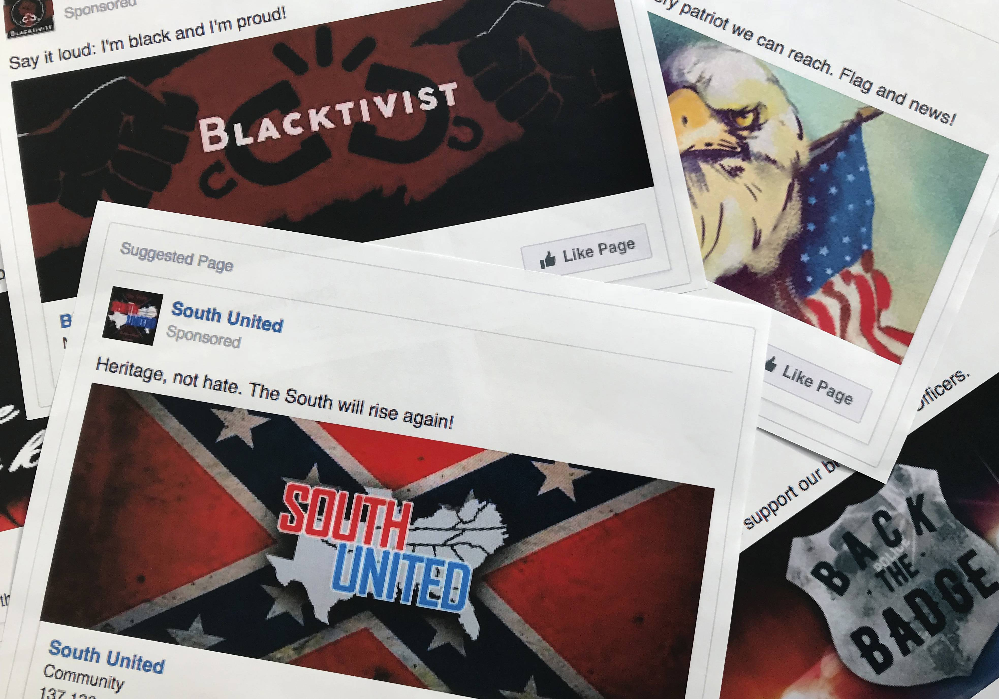 Some of the Facebook ads linked to a Russian effort to disrupt the American political process and stir up tensions around divisive social issues, released by members of the U.S. House Intelligence committee, are photographed in Washington, on Wednesday, Nov. 1, 2017.