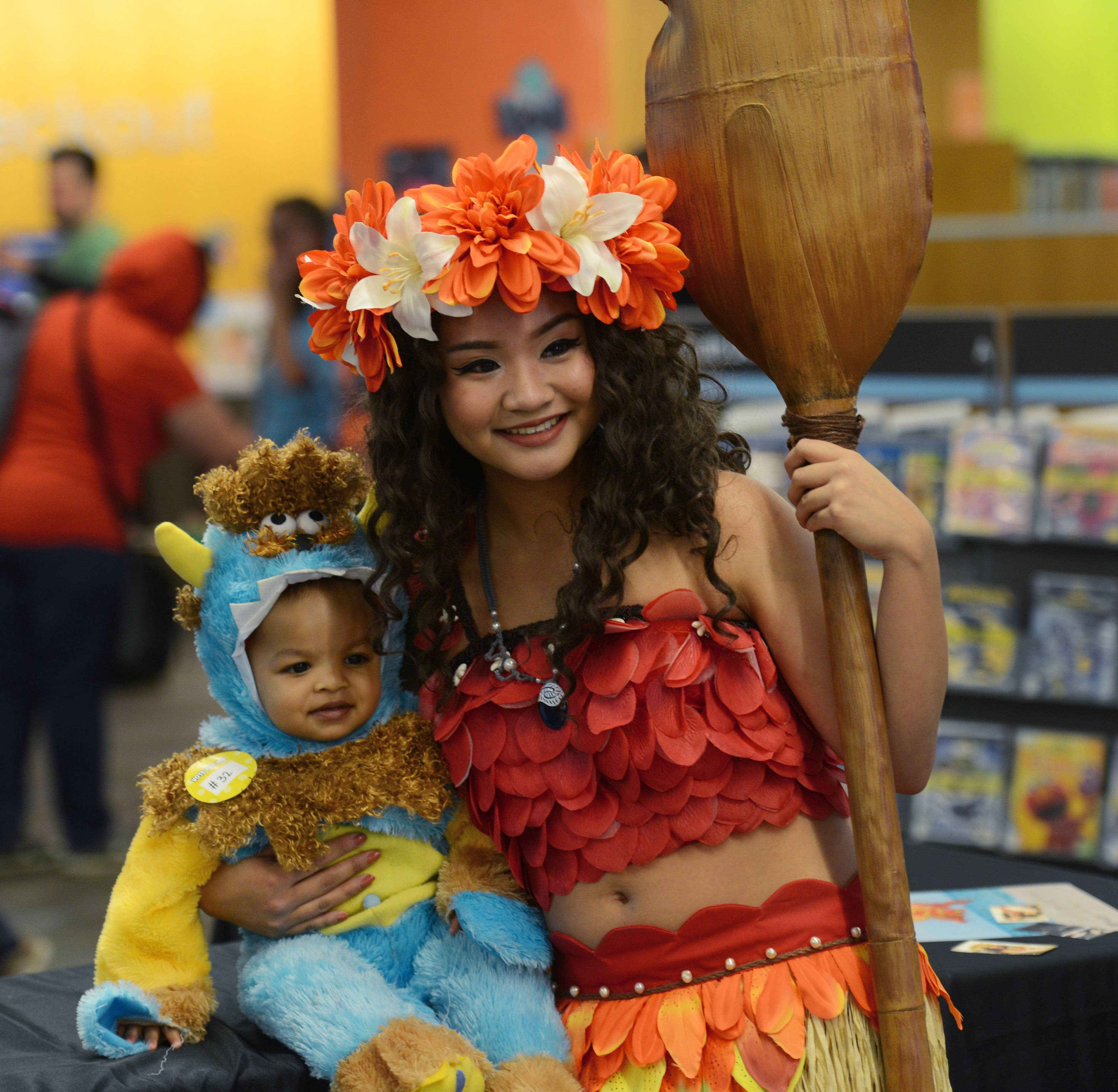 Tiny monster boy Abhinav Aukula, 1, visits with Samantha Sanchez, dressed as Disney's Moana, during the fourth annual Mini Comic Con at the Vernon Area Public Library in Lincolnshire Saturday.