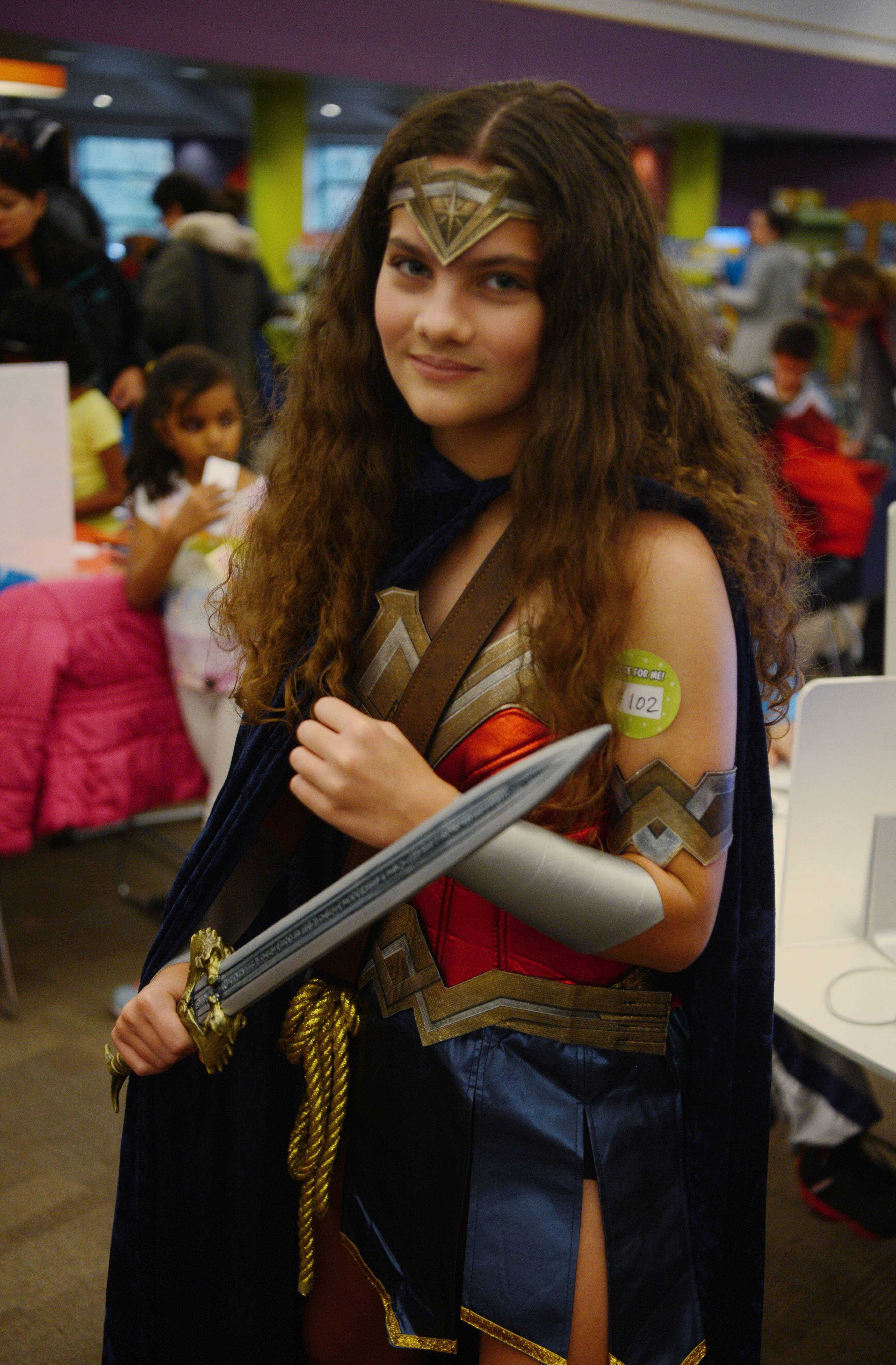 Emma Doiron, 13, of Lincolnshire is dressed as Wonder Woman during the fourth annual Mini Comic Con at the Vernon Area Public Library in Lincolnshire Saturday.