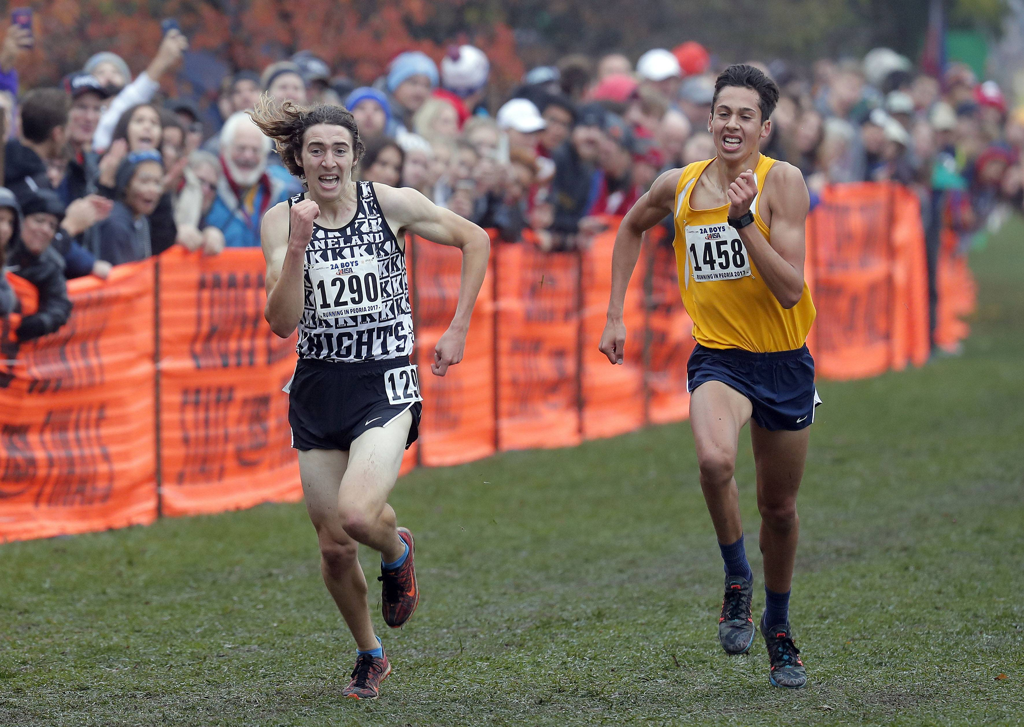 Kaneland's Matthew Richtman (1290) and Sterling's Jacob Gebhardt (1458) power to the finish during the boys Class 2A cross country finals Saturday in Peoria.
