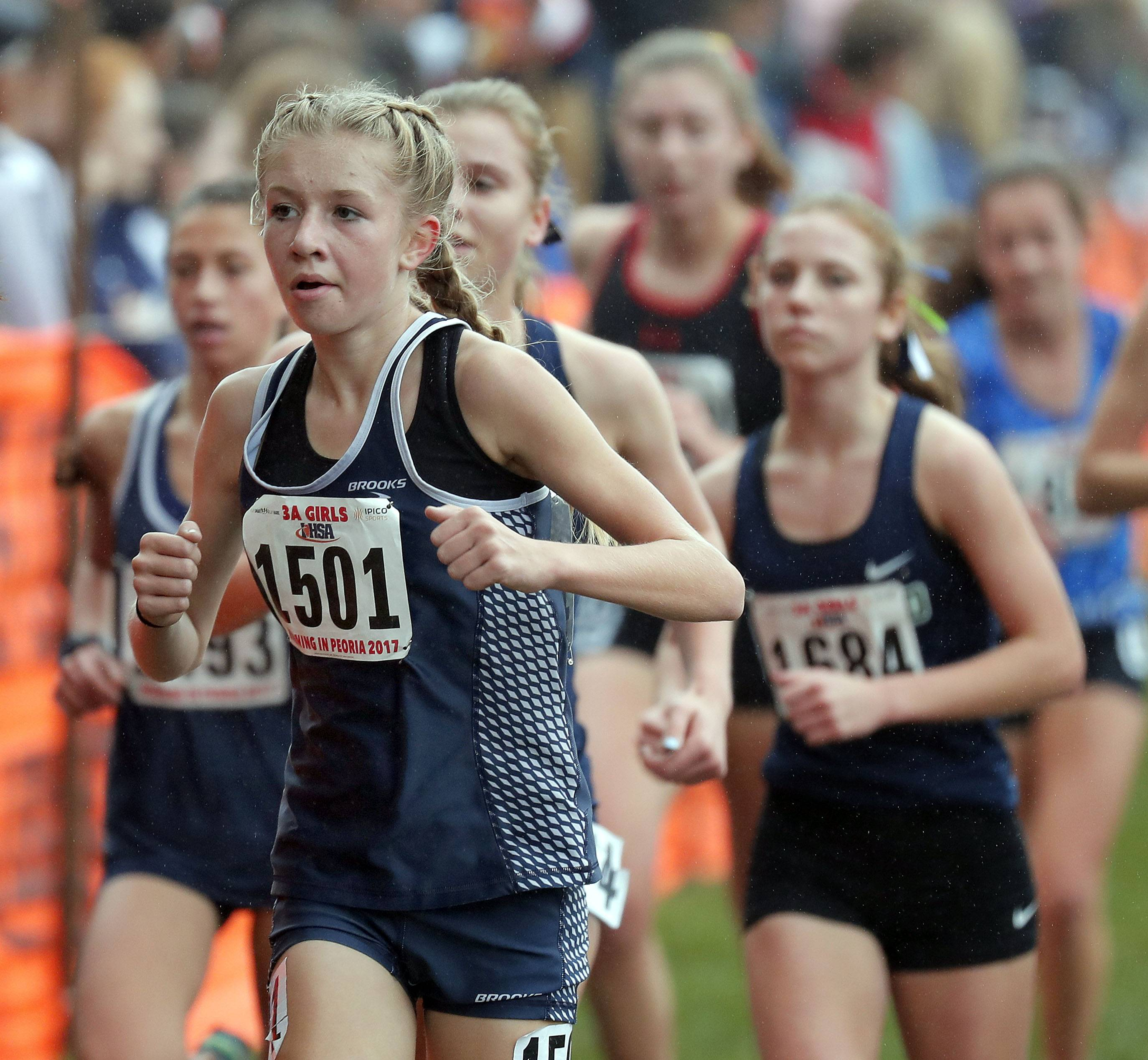 Cary Grove's Ellie Miller (1501) runs during the girls Class 3A cross country finals Saturday in Peoria.