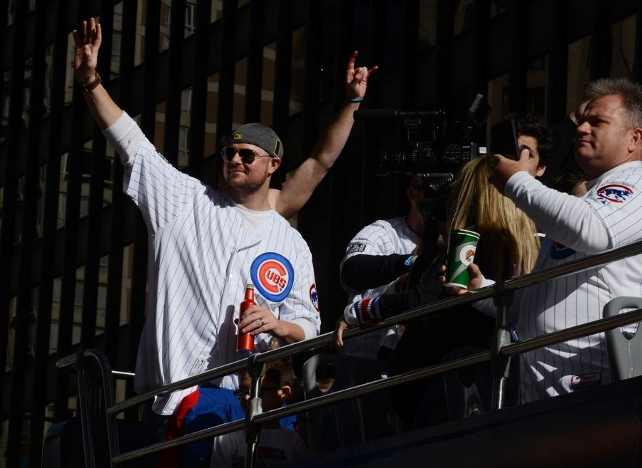 Starting pitcher Jon Lester rides in the Chicago Cubs World Series championship parade along Michigan Avenue last Novemember. A year ago Saturday, billions made the pilgrimage to Grant Park, paying homage to the world champs, on bended knees in tribute to those who delivered the faithful from a century-old nightmare. The just-concluded World Series is a reminder for Cubs of how hard it is to return, let alone repeat.