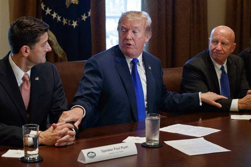 In this Nov. 2, 2017, photo, President Donald Trump speaks during a meeting on tax policy with Republican lawmakers in the Cabinet Room of the White House in Washington, with House Speaker Paul Ryan of Wis., and Chairman of the House Ways and Means Committee Rep. Kevin Brady, R-Texas, right. Terrorism, taxes and Russia tribulations provided fertile ground for President Donald Trump and others to sow confusion over the past week.