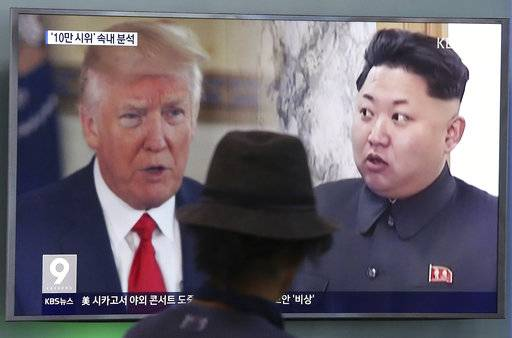 FILE - In this Aug. 10, 2017, file photo, a man watches a television screen showing U.S. President Donald Trump and North Korean leader Kim Jong Un during a news program at the Seoul Train Station in Seoul, South Korea. The only way to locate and destroy with complete certainty all components of North Korea's nuclear weapons program is through a ground invasion. That blunt assessment from the Pentagon is in response to a letter from two Democratic congressmen asking about casualty assessments in a conflict with North Korea.