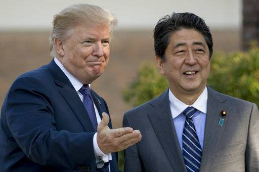 President Donald Trump, left, greets Japanese Prime Minister Shinzo Abe at Kasumigaseki Country Club, Sunday, Nov. 5, 2017, in Kawagoe, north of Tokyo, Japan. Trump is on a five country trip through Asia traveling to Japan, South Korea, China, Vietnam and the Philippians.