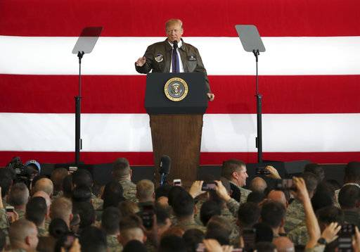 U.S. President Donald Trump addresses the U.S. troops at the U.S. Yokota Air Base, on the outskirts of Tokyo, Sunday, Nov. 5, 2017.  President Trump arrived in Japan Sunday on a five-nation trip to Asia, his second extended foreign trip since taking office and his first to Asia. The trip will take him to Japan, South Korea, China, Vietnam and Philippines for summits of the Asia-Pacific Economic Cooperation (APEC) and the Association of Southeast Asian Nations (ASEAN).