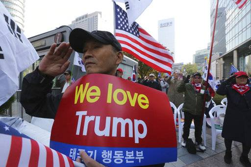 Protesters against North Korea salute during a rally welcoming the planned visit by U.S. President Donald Trump in Seoul, South Korea, Saturday, Nov. 4, 2017.