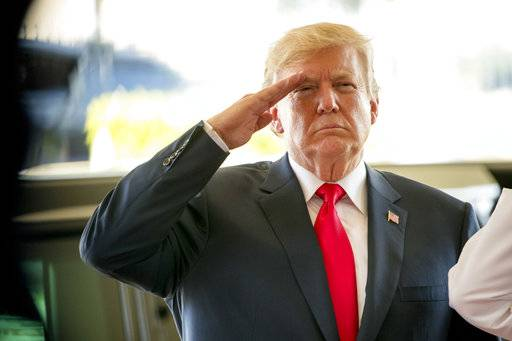 President Donald Trump salutes during a welcome ceremony at U.S. Pacific Command (PACOM), Friday, Nov. 3, 2017, in Aiea, Hawaii. Trump begins a 5 country trip through Asia traveling to Japan, South Korea, China, Vietnam and the Philippians.
