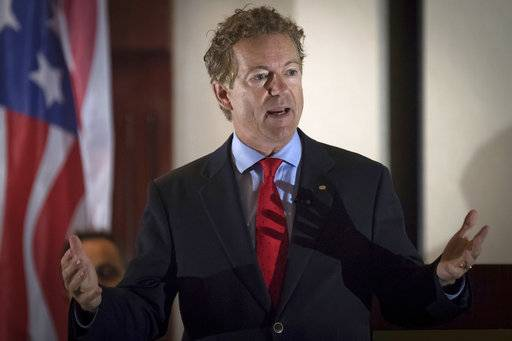 "In this Aug. 11, 2017 photo, Sen. Rand Paul, R-Ky., speaks to supporters in Hebron, Ky. A man has been arrested and charged with assaulting and injuring Rand Paul. Kentucky State Police said in a news release Saturday, Nov. 4, 2017 that Paul suffered a minor injury when 59-year-old Rene Boucher assaulted him at his Warren County home on Friday afternoon. The release did not provide details of the assault or the nature of Paul's injury. In a statement, Paul spokeswoman Kelsey Cooper said the Republican senator was ""fine."""