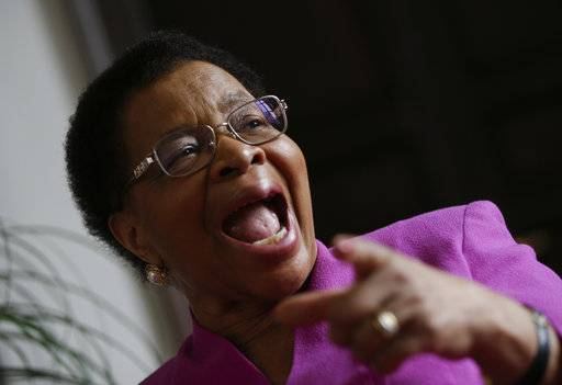 Mandela's widow Graca Machel gestures as she answers to the Associated Press journalist during an interview at Palazzo Reale, in Milan, Italy, Saturday, Nov. 4, 2017. Former U.N. Secretary General Kofi Annan and Graca Machel are addressing a summit on the global crisis of malnutrition that is an underlying cause of half of child deaths.