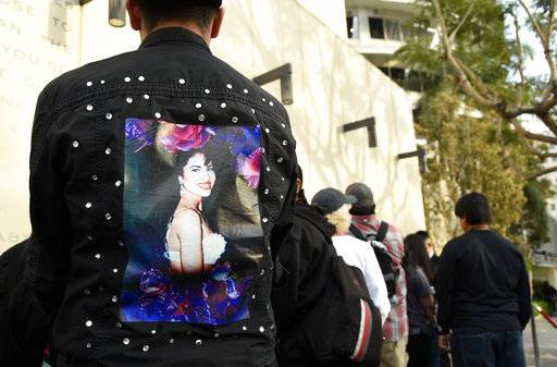 Fans of the late singer Selena Quintanilla wait in line to attend a ceremony to award her a posthumous star on the Hollywood Walk of Fame on Friday, Nov. 3, 2017, in Los Angeles. (Photo by Chris Pizzello/Invision/AP)