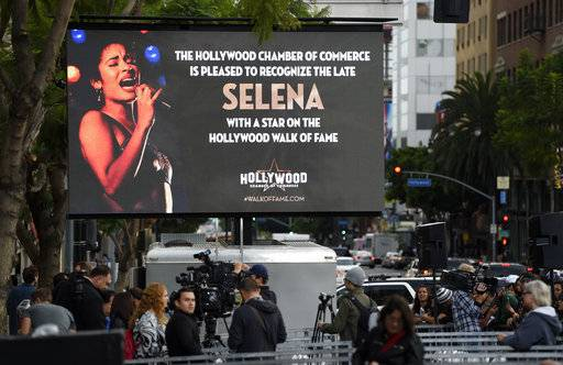 A video screen advertises a ceremony to award the late singer Selena Quintanilla a posthumous star on the Hollywood Walk of Fame on Friday, Nov. 3, 2017, in Los Angeles. (Photo by Chris Pizzello/Invision/AP)