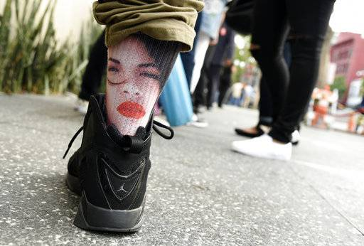 A fan of the late singer Selena Quintanilla wears socks bearing her image before a ceremony to award her a posthumous star on the Hollywood Walk of Fame on Friday, Nov. 3, 2017, in Los Angeles. (Photo by Chris Pizzello/Invision/AP)