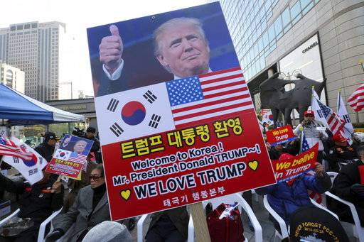Protesters against North Korea stage a rally welcoming a planned visit by U.S. President Donald Trump in Seoul, South Korea, Saturday, Nov. 4, 2017.
