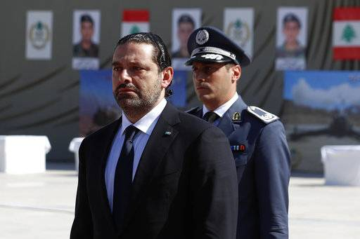 "In this photo taken on Friday, Sept. 8, 2017, Lebanese Prime Minister Saad Hariri, left, arrives for a mass funeral of ten Lebanese soldiers at the Lebanese Defense Ministry, in Yarzeh near Beirut, Lebanon. Lebanese prime minister Saad Hariri has announced he is resigning in a surprise move following a trip to Saudi Arabia. In a televised address Saturday, Nov. 4, he slammed Iran and the Lebanese Hezbollah group for meddling in Arab affairs and says ""Iran's arms in the region will be cut off."""