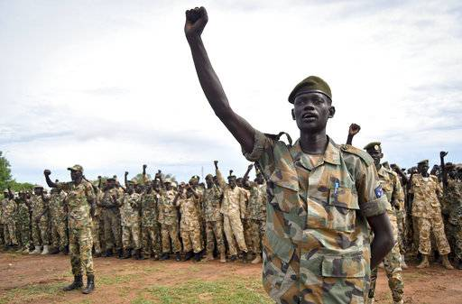 FILE - In this Thursday, May 18, 2017, file photo, soldiers cheer at a ceremony marking the 34th anniversary of the Sudan People's Liberation Army (SPLA), attended by President Salva Kiir, in the capital Juba, South Sudan. Tensions are high Saturday, Nov. 4, 2017, in Juba after President Salva Kiir sent troops to surround the home of former military chief of staff Paul Malong, disarm his bodyguards and remove all weapons.