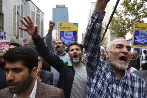 Demonstrators chant slogans during an annual rally marking the anniversary of the 1979 U.S. Embassy takeover in Tehran, Iran, Saturday, Nov. 4, 2017. Iran on Saturday displayed a surface-to-surface missile as part of events marking the anniversary of the 1979 U.S. Embassy takeover and hostage crisis amid uncertainty about its nuclear deal with world powers.