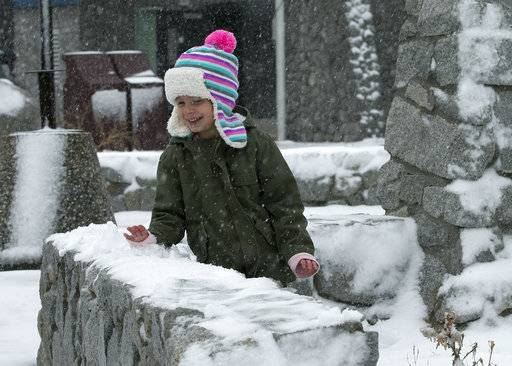 Macyn Margiaracina, 4, plays in the snow at a rest stop Friday, Nov. 3, 2017, at Donner Summit, Calif. A light snow fell in the upper elevations of the Sierra Nevada overnight, with up to 2 feet of snow forecast to fall in elevations above 8,000 feet and at least a foot of snow is expected in Donner and Tioga passes and other areas above 6,000 feet and up this weekend, forecasters said.