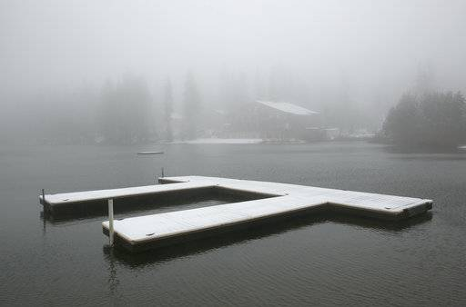 Snow blankets docks at Serene Lakes, near Soda Springs, Calif., Friday, Nov. 3, 2017. A light snow fell in the upper elevations of the Sierra Nevada overnight, with up to 2 feet of snow forecast to fall in elevations above 8,000 feet and at least a foot of snow is expected in Donner and Tioga passes and other areas above 6,000 feet and up this weekend, forecasters said.