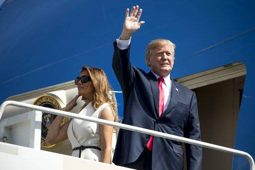 President Donald Trump and first lady Melania Trump arrive at Joint Base Pearl Harbor Hickam, Hawaii, Friday, Nov. 3, 2017. Trump begins a 5 country trip through Asia traveling to Japan, South Korea, China, Vietnam and the Philippians.