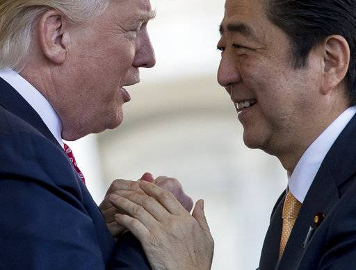 FILE - In this Feb. 10, 2017, file photo, U.S. President Donald Trump, left, welcomes Japanese Prime Minister Shinzo Abe outside the West Wing of the White House in Washington. Trump can expect a friendly reception in Japan, his first stop on a five-nation Asia trip that kicks off Sunday, Nov. 5, 2017.