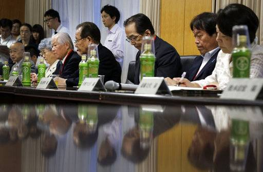 FILE - In this July 4, 2014, file photo, Japanese abductees' family members, seated from left to right, Masaru Honma, Sakie Yokota, Shigeru Yokota, Shigeo Izuka, Shichirou Hamamoto, Teruaki Masumoto and Fumiko Hirano bow slightly as Japan's Abduction Issue Minister Keiji Furuya, not in picture, speaks prior to a briefing in Tokyo. U.S. President Donald Trump plans to meet with the relatives of some of the abductees while he is in Japan.