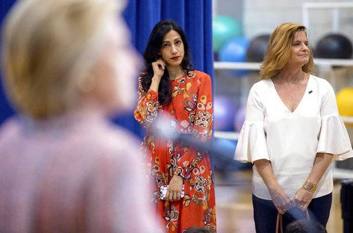 FILE - In this Thursday, Sept. 15, 2016 file photo, senior aide Huma Abedin, center, and Director of Communications Jennifer Palmieri, right, stand nearby as Democratic presidential candidate Hillary Clinton answers a question after a rally in Greensboro, N.C. On the 22nd, 23rd and 25th of March 2016, three volleys of malicious messages were generated targeting Abedin and Palmieri, among many others.
