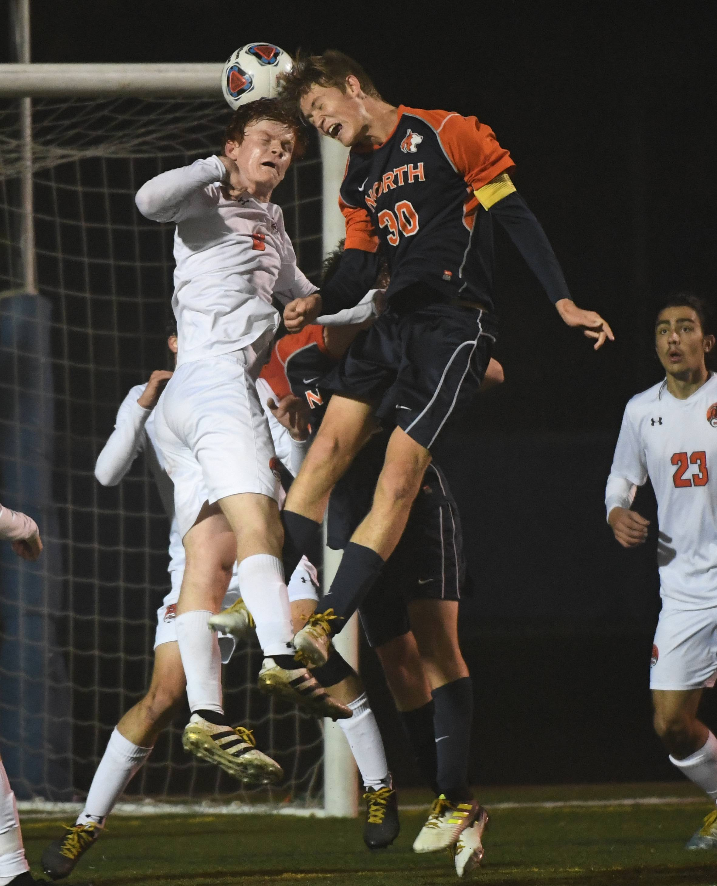 Naperville North's Colin Iverson heads the ball into the goal with Libertyville's Evan Rasmussen defending for the only score in Saturday's Class 3A state championship game at Hoffman Estates.