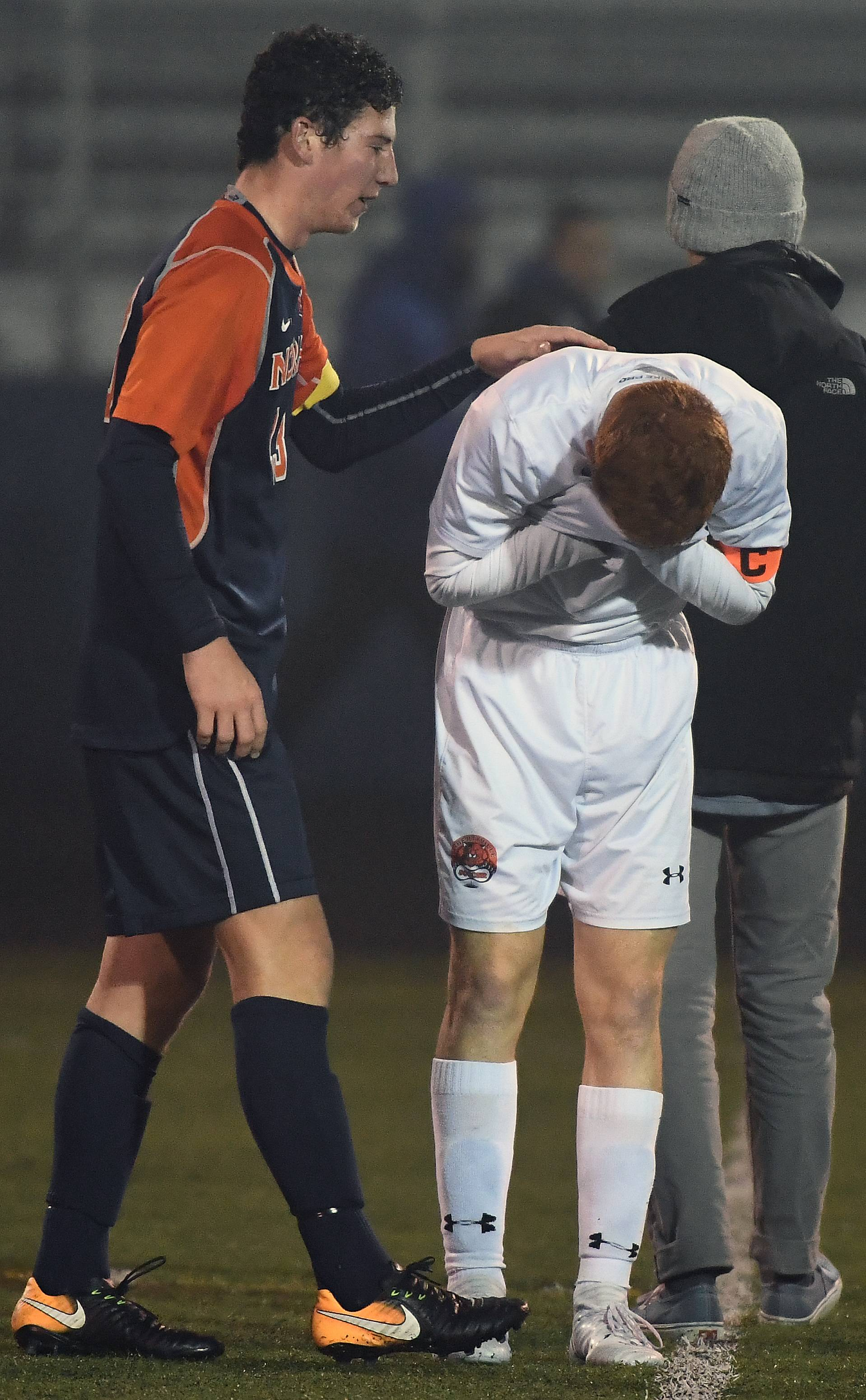 Naperville North's Jack Barry consoles Libertyville's Ryan Wittenbrink after the Wildcats' 1-0 loss in the Class 3A boys soccer state championship game at Hoffman Estates.