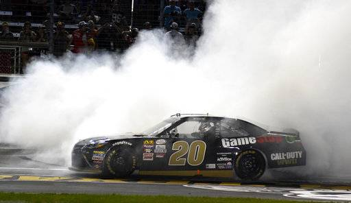 Erik Jones (20) does a burnout after winning a NASCAR Xfinity Series auto race at Texas Motor Speedway in Fort Worth, Texas, Saturday, Nov. 4, 2017.