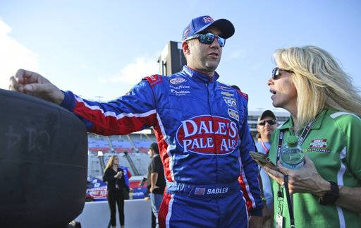 Elliot Sadler, left, talks on pit row before qualifying for a NASCAR Xfinity series auto race at Texas Motor Speedway in Fort Worth, Texas, Saturday, Nov. 4, 2017.