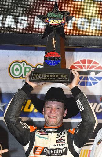 Erik Jones hold up his trophy in Victory Lane after winning a NASCAR Xfinity Series auto race at Texas Motor Speedway in Fort Worth, Texas, Saturday, Nov. 4, 2017.