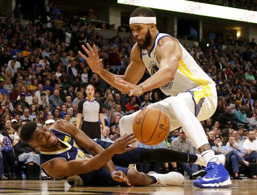Denver Nuggets guard Emmanuel Mudiay, left, passes the ball from the floor as Golden State Warriors center JaVale McGee guards during the third quarter of an NBA basketball game Saturday, Nov. 4, 2017, in Denver. (Photo by Jack Dempsey)