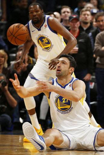 Golden State Warriors center Zaza Pachulia (27) passes the ball against the Denver Nuggets during the first quarter of an NBA basketball game Saturday, Nov. 4, 2017, in Denver. (Photo by Jack Dempsey)