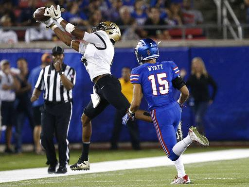 Central Florida wide receiver Tre'Quan Smith (4) makes the catch as SMU defensive back Jordan Wyatt (15) defends during the first half of an NCAA college football game, Saturday, Nov. 4, 2017, in Dallas.