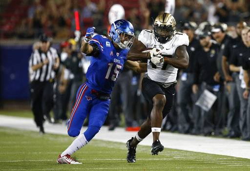 Central Florida wide receiver Marlon Williams (17) runs after making the catch as SMU defensive back Jordan Wyatt (15) defends during the first half of an NCAA college football game, Saturday, Nov. 4, 2017, in Dallas.