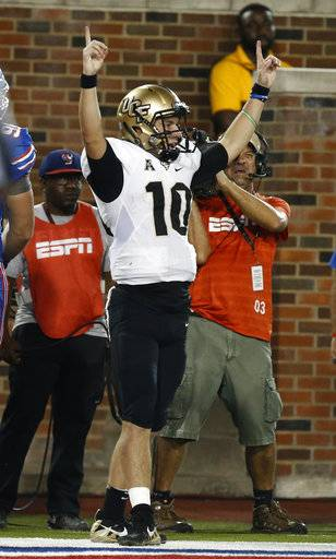 UCF quarterback McKenzie Milton (10) celebrates after scoring a touchdown against SMU during the first half of an NCAA college football game, Saturday, Nov. 4, 2017, in Dallas, Texas.