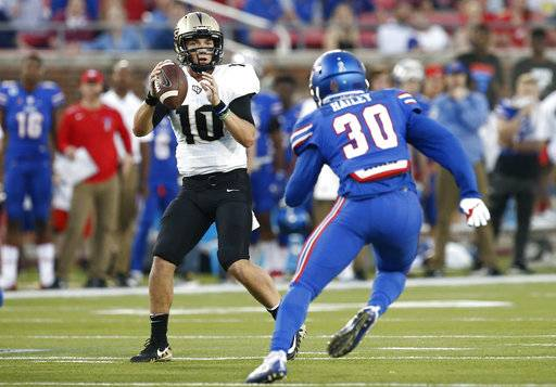 Central Florida quarterback McKenzie Milton (10) drops back to pass as SMU linebacker Shaine Hailey (30) defends during the first half of an NCAA college football game, Saturday, Nov. 4, 2017, in Dallas.