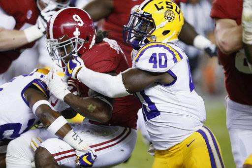 Alabama running back Bo Scarbrough is tackled by LSU linebacker Devin White during the first half of an NCAA college football game, Saturday, Nov. 4, 2017, in Tuscaloosa, Ala.