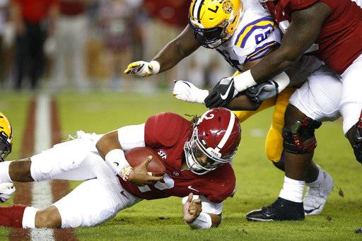 Alabama quarterback Jalen Hurts is sacked by LSU defensive end Christian LaCouture during the first half of an NCAA college football game, Saturday, Nov. 4, 2017, in Tuscaloosa, Ala.