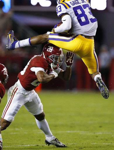 LSU wide receiver Russell Gage jumps over Alabama defensive back Minkah Fitzpatrick during the first half of an NCAA college football game, Saturday, Nov. 4, 2017, in Tuscaloosa, Ala.
