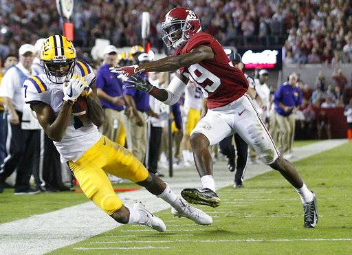 LSU wide receiver D.J. Chark catches the ball against Alabama defensive back Levi Wallace during the first half of an NCAA college football game, Saturday, Nov. 4, 2017, in Tuscaloosa, Ala.